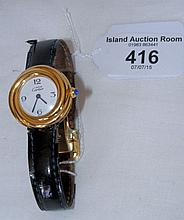 A lady's Cartier wristwatch with leather strap