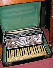 A Rialto piano accordion in carrying case