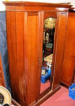 Mahogany hanging robe enclosed by bevelled mirrored centre door