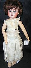 An old French bisque head doll with rolling eyes and open mouth, having com