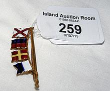 An enamel sailing flag brooch - 9ct gold setting by Benzie of Cowes