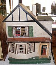 An old TRI-ANG 1940's style wooden dolls house with vintage furniture - 54c