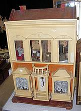 An antique G & J Lines No.13 dolls house with four rooms fitted with vintag