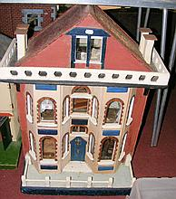 An antique wooden dolls house with three rooms and antic room, fitted with