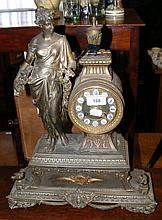 French style striking mantel clock with figural surmount