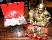 Various collectable coinage, together with a Buddha table lamp