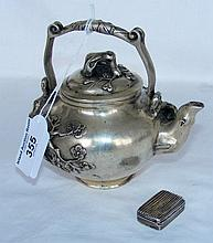 Metal oriental teapot, together with a silver vinaigrette