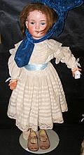 An old large German bisque head doll with blue glass eyes and open mouth, c