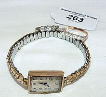Lady's gold cased wristwatch, together with two dress rings