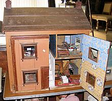An old large wooden town dolls house with four rooms fitted with vintage fu