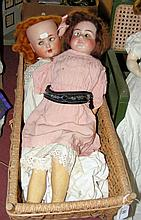 Two old German bisque head dolls with composite bodies, in original vintage