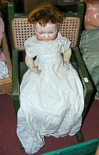 An old German bisque head doll with composite body, in original clothing, f