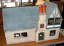 """A 1930's """"Mayflower"""" vintage dolls house with blue tiled roof, fitted with"""