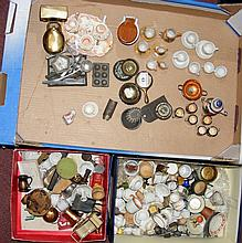 Three boxes containing vintage dolls house furniture, including teasets, to