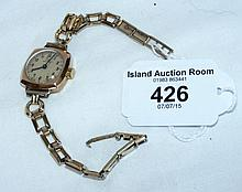 A 9ct gold lady's wristwatch with strap