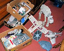 Four boxes containing various collectable Star Wars aircraft, characters, e
