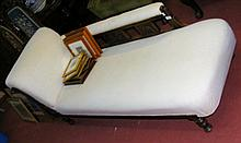 An Edwardian chaise longue on turned supports