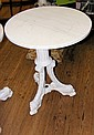 A cast iron garden table with circular marble top