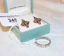 Diamond eternity ring in gold setting