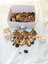 A box of military buttons