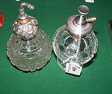 Two antique perfume atomizers with decorative tops