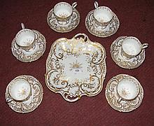 Decorative gilt teaset with two handled cake plate