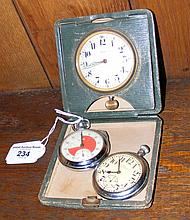 An eight day travelling clock, together with two pocket watches