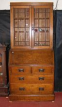An oak bureau bookcase with fitted interior