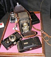 A Rolleiflex Camera, together with others