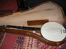 An old banjo in fitted carrying case