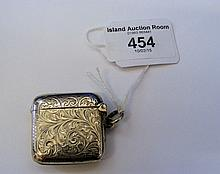 A silver vesta case with engraved decoration