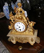 A French mantel clock with figural surmount