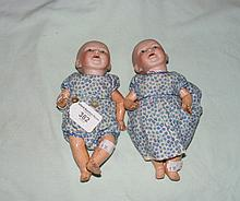 A pair of miniature bisque head baby dolls - 20cm long