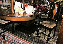 A French antique extending dining table with a set of seven matching dining chairs