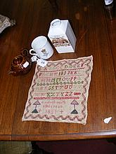 An antique sampler dated 1831, together with two commemorative pieces of ceramicware and a miniature teapot