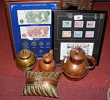 An interesting Middle Eastern style brass and copper bound lady's purse, together with collectable stamps, banknotes, etc.