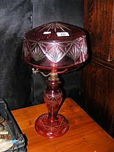 A decorative overlay glass table lamp