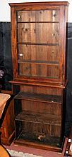 An oak glazed bookcase