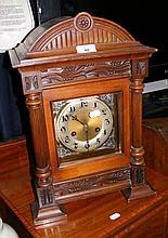 An Edwardian striking mantel clock in decorative carved case - 46cm
