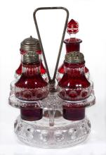 KING'S CROWN / EXCELSIOR (OMN) - RUBY-STAINED FOUR-BOTTLE CASTER SET