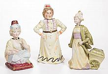 CONTINENTAL BISQUE AND GLAZED PORCELAIN FEMALE NODDERS, LOT OF THREE