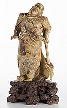 CHINESE SOAPSTONE CARVING OF A FIERCE GUARDIAN / WARRIOR