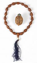 CHINESE CARVED NUT CORD NECKLACE AND SNUFF BOTTLE
