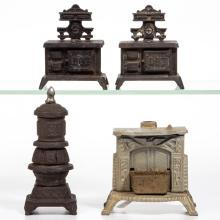 ASSORTED STOVE CAST-IRON PENNY BANKS, LOT OF FOUR
