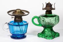 ASSORTED GLASS KEROSENE FOOTED FINGER LAMPS, LOT OF TWO