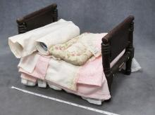 ANTIQUE DOLL'S ROPE BED WITH BEDDING