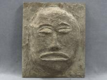 EUGENE WADDELL (AMERICAN 20TH CENTURY), MOUNTED RELIEF SCULPTURE, ARCHAIC FACE, SIGNED. HEIGHT 20