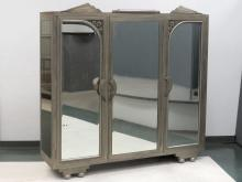 RARE ART DECO ARMOIRE IN NICKLE WITH BEVELED MIRROR DOORS AND CAST FLORAL ACCENTS. HEIGHT 74