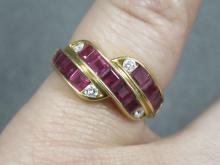 750 YELLOW GOLD RUBY AND DIAMOND RING. RING SIZE 5 3/4; GROSS WEIGHT 4.96 GRAMS
