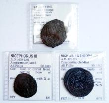 LOT (3) BYZANTINE BRONZE COINS INCLUDING MAURICE TIBERIUS (592-593 AD) AE FOLLIS, 30MM (VF); MICHEL II AND THEOPHILUS (821-829 AD) AE FOLLIS, 31MM (VF); NICEPHORUS III (1078-1081 AD) AE FOLLIS, 25MM